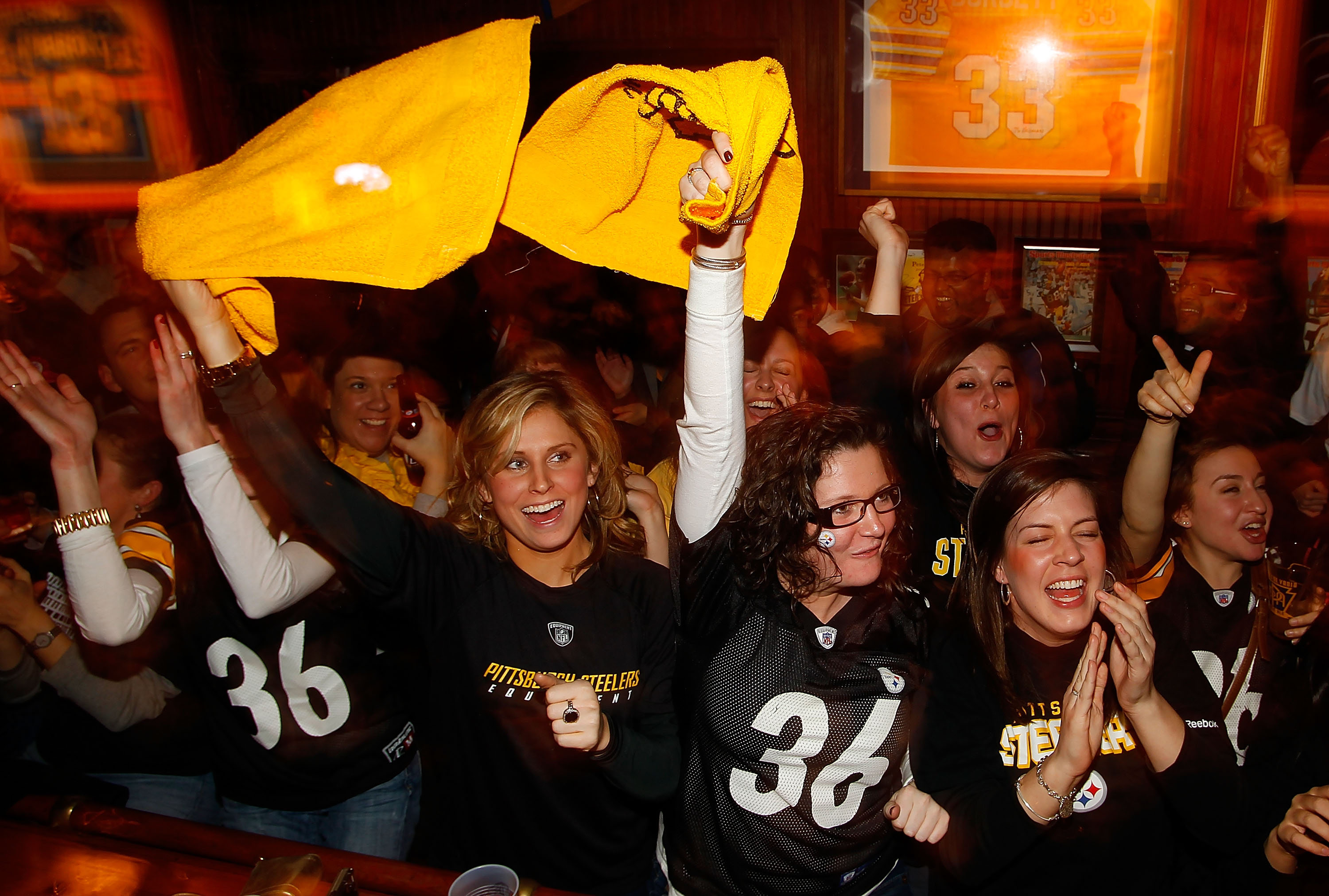 PITTSBURGH - FEBRUARY 06:  Pittsburgh Steelers fans watch Super Bowl XLV on February 6, 2011 at Peter's Pub in the Oakland neighborhood of Pittsburgh, Pennsylvania.  (Photo by Jared Wickerham/Getty Images)