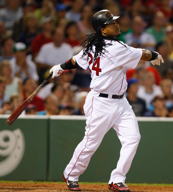 BOSTON - JULY 30: Manny Ramirez #24 of the Boston Red Sox watches the flight of a fly ball during his last at bat with the Red Sox against the Los Angeles Angels of Anaheim at Fenway Park on July 30, 2008 in Boston, Massachusetts.  (Photo by Jim Rogash/Ge