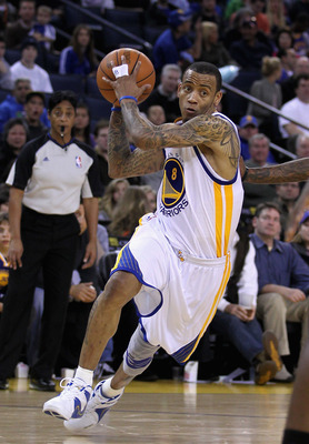 OAKLAND, CA - MARCH 25: Monta Ellis #8 of the Golden State Warriors drives to the basket against the Toronto Raptors at Oracle Arena on March 25, 2011 in Oakland, California. NOTE TO USER: User expressly acknowledges and agrees that, by downloading and or
