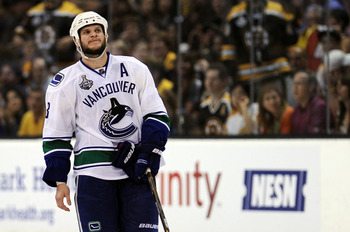 BOSTON, MA - JUNE 08:  Kevin Bieksa #3 of the Vancouver Canucks looks on after a play against the Boston Bruins during Game Four of the 2011 NHL Stanley Cup Final at TD Garden on June 8, 2011 in Boston, Massachusetts.  (Photo by Harry How/Getty Images)