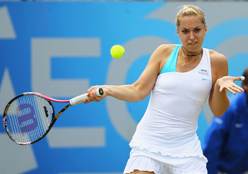 BIRMINGHAM, ENGLAND - JUNE 13:  Sabine Lisicki of Germany plays a forehand during the Ladies Final against Daniela Hantuchova of Slovakia during day eight of the AEGON Classic at the Edgbaston Priory Club on June 13, 2011 in Birmingham, England.  (Photo b