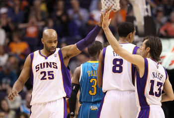 PHOENIX, AZ - JANUARY 30:  Vince Carter #25 of the Phoenix Suns high fives teammate Steve Nash #13 after scoring against the New Orleans Hornets during the NBA game at US Airways Center on January 30, 2011 in Phoenix, Arizona.  The Suns defeated the Horne