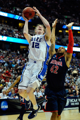 ANAHEIM, CA - MARCH 24:  Kyle Singler #12 of the Duke Blue Devils goes to the basket against Jamelle Horne #42 of the Arizona Wildcats during the west regional semifinal of the 2011 NCAA men's basketball tournament at the Honda Center on March 24, 2011 in