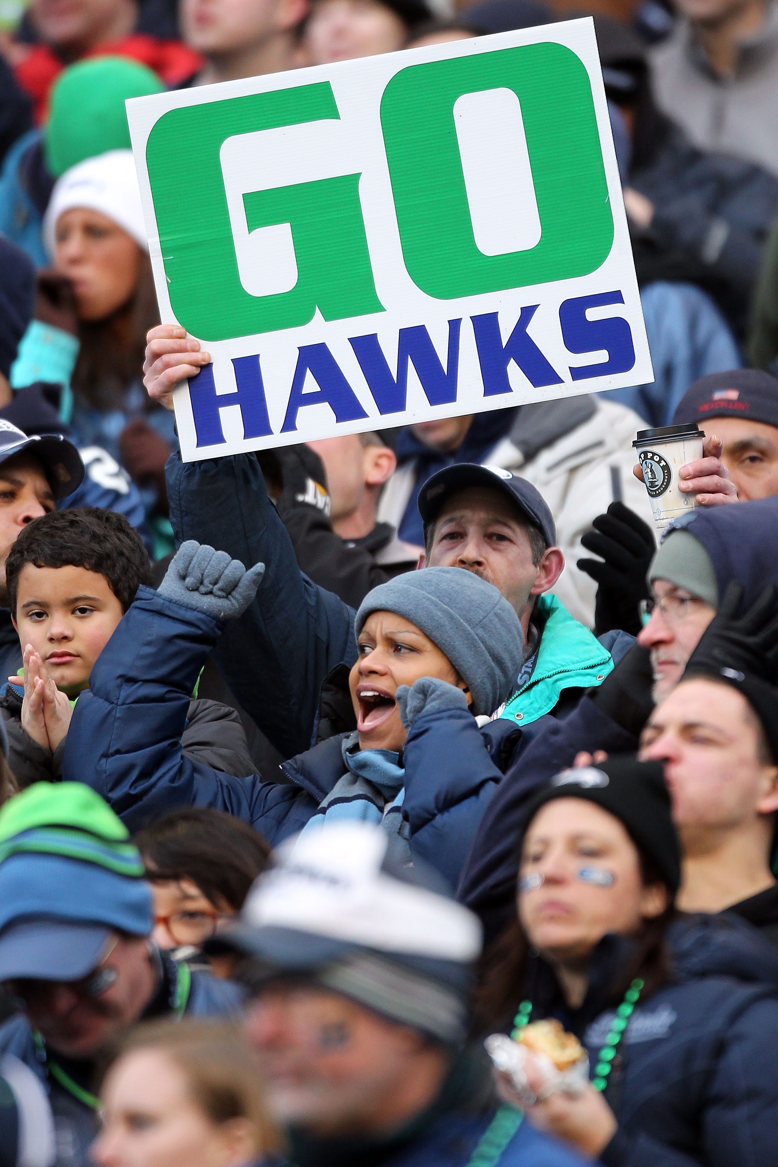 SEATTLE, WA - JANUARY 08:  Fans of the Seattle Seahawks cheer in the second half as the Seahawks take on the New Orleans Saints during the 2011 NFC wild-card playoff game at Qwest Field on January 8, 2011 in Seattle, Washington.  (Photo by Otto Greule Jr/