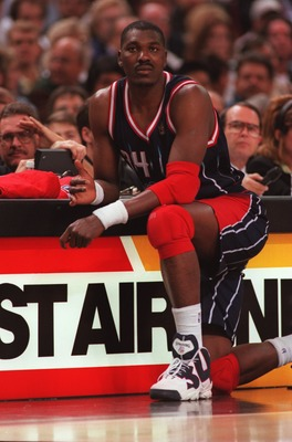 5 Nov 1996:  Center Hakeem Olajuwon of the Houston Rockets waits to enter the game during the Rockets 102-80 win over the Sacramento Kings at Arco Arena in Sacramento, California.  Mandatory Credit:  Otto Gruele/Allsport