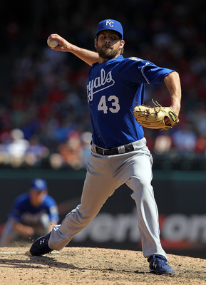 ARLINGTON, TX - MAY 29:  Aaron Crow #43 of the Kansas City Royals throws against the Texas Rangers at Rangers Ballpark in Arlington on May 29, 2011 in Arlington, Texas.  (Photo by Ronald Martinez/Getty Images)