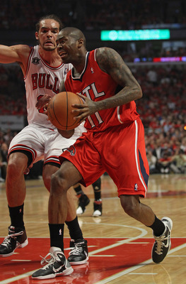 CHICAGO, IL - MAY 10: Jamal Crawford #11 of the Atlanta Hawks drives past Joakim Noah #13 of the Chicago Bulls in Game Five of the Eastern Conference Semifinals in the 2011 NBA Playoffs at the United Center on May 10, 2011 in Chicago, Illinois. The Bulls
