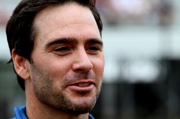 LONG POND, PA - JUNE 12:  Jimmie Johnson, driver of the #48 Lowe's Chevrolet, stands on the grid prior to the NASCAR Sprint Cup Series 5-Hour Energy 500 at Pocono Raceway on June 12, 2011 in Long Pond, Pennsylvania.  (Photo by Jerry Markland/Getty Images