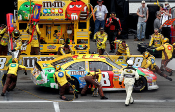 LONG POND, PA - JUNE 12:  Kyle Busch, driver of the #18 M&M's Toyota, makes a pit stop during the NASCAR Sprint Cup Series 5-Hour Energy 500 at Pocono Raceway on June 12, 2011 in Long Pond, Pennsylvania.  (Photo by Jerry Markland/Getty Images for NASCAR)