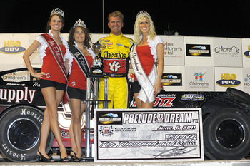 ROSSBURG, OH - JUNE 08:  Clint Bowyer, driver of the #33 Crawford Supply/Klotz Synthetic Lubrication Chevrolet, poses in Victory Lane after winning the running of Prelude To The Dream at Eldora Speedway on June 8, 2011 in Rossburg, Ohio.  (Photo by Jared
