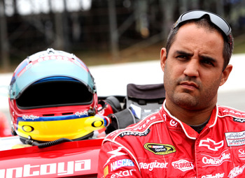 LONG POND, PA - JUNE 12:  Juan Pablo Montoya, driver of the #42 Target Chevrolet, stands on the grid prior to the NASCAR Sprint Cup Series 5-Hour Energy 500 at Pocono Raceway on June 12, 2011 in Long Pond, Pennsylvania.  (Photo by Jerry Markland/Getty Ima