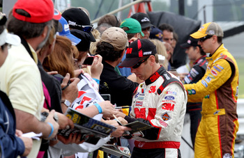 LONG POND, PA - JUNE 11:  Greg Biffle, driver of the #16 3M Ford, signs autographs during qualifying for the NASCAR Sprint Cup Series 5-Hour Energy 500 at Pocono Raceway on June 11, 2011 in Long Pond, Pennsylvania.  (Photo by Jerry Markland/Getty Images f
