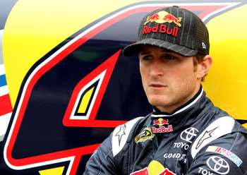 LONG POND, PA - JUNE 12:  Kasey Kahne, driver of the #4 Red Bull Toyota, sits next to his car on the grid prior to the NASCAR Sprint Cup Series 5-Hour Energy 500 at Pocono Raceway on June 12, 2011 in Long Pond, Pennsylvania.  (Photo by Jerry Markland/Gett