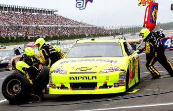 LONG POND, PA - JUNE 12:  Paul Menard, driver of the #27 Pittsburgh Paints/Menards Chevrolet, makes a pit stop during the NASCAR Sprint Cup Series 5-Hour Energy 500 at Pocono Raceway on June 12, 2011 in Long Pond, Pennsylvania.  (Photo by Jerry Markland/G