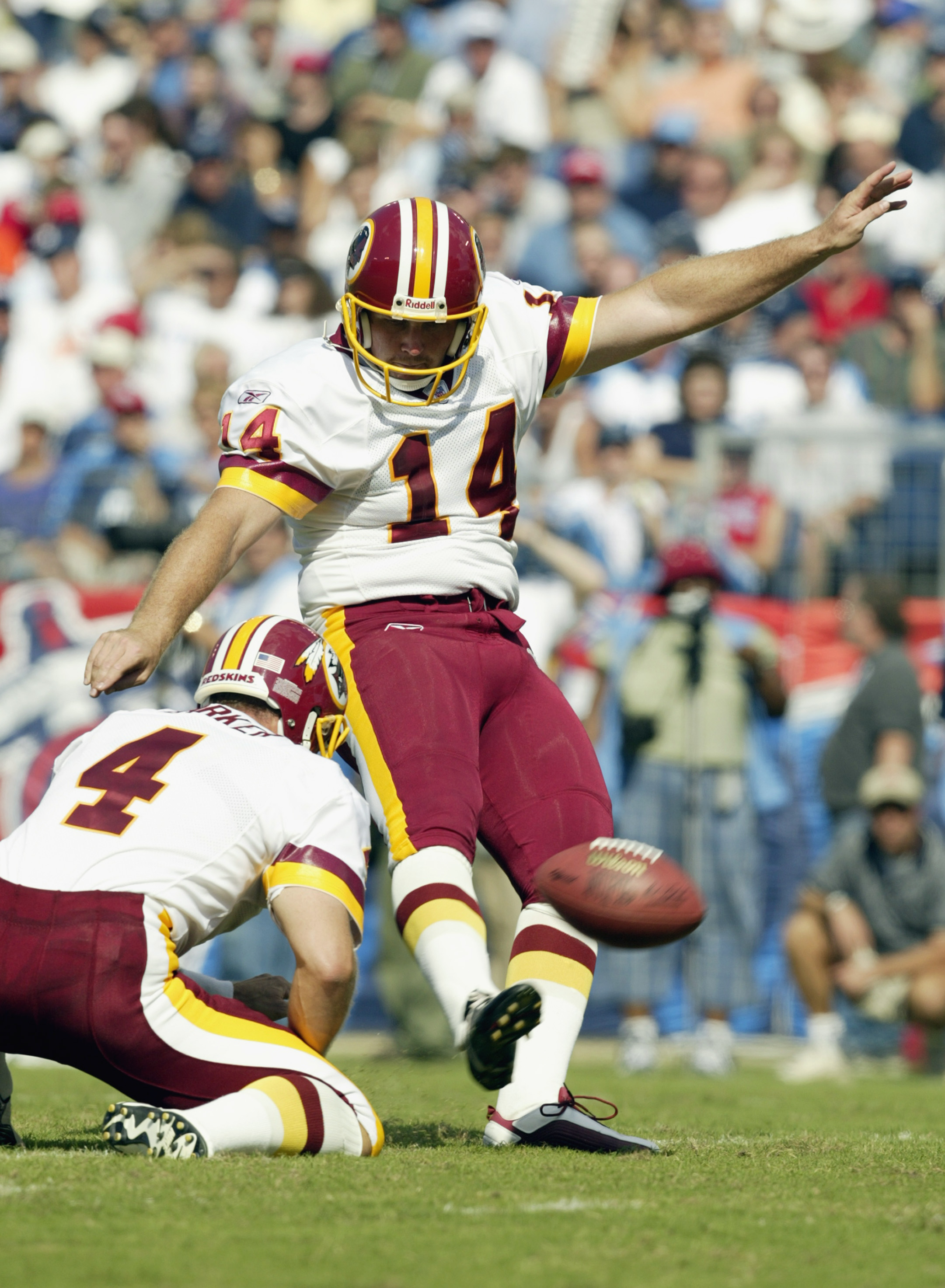 ST. LOUIS - OCTOBER 6:  Kicker James Tuthill #14 of the Washington Redskins scores a field goal as punter Bryan Barker #4 holds the ball during their NFL game on October 6, 2002 at The Coliseum in Nashville, Tennessee.  The Redskins won 31-14.  (Photo by