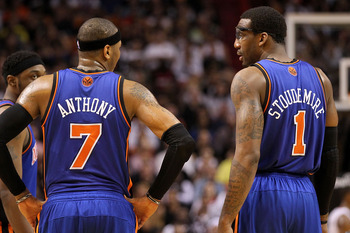 MIAMI, FL - FEBRUARY 27:  Carmelo Anthony #7 and Amar'e Stoudemire #1 of the New York Knicks talk during a game against the the Miami Heat at American Airlines Arena on February 27, 2011 in Miami, Florida. NOTE TO USER: User expressly acknowledges and agr