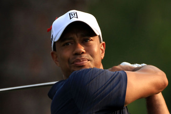PONTE VEDRA BEACH, FL - MAY 12:  Tiger Woods hits his tee shot on the second hole during the first round of THE PLAYERS Championship held at THE PLAYERS Stadium course at TPC Sawgrass on May 12, 2011 in Ponte Vedra Beach, Florida.  (Photo by Streeter Leck