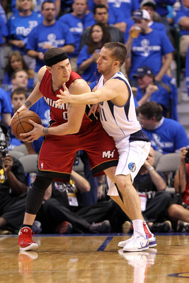 DALLAS, TX - JUNE 07:  Mike Bibby #0 of the Miami Heat looks to pass against Jose Juan Barea #11 of the Dallas Mavericks in Game Four of the 2011 NBA Finals at American Airlines Center on June 7, 2011 in Dallas, Texas. The Mavericks won 86-83. NOTE TO USE