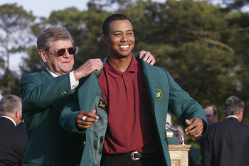AUGUSTA, GA.- APRIL 14:  Tiger Woods is awarded the green jacket after winning the Masters Tournament at the Augusta National Golf Club on April 14 , 2002 in Augusta, Georgia. DIGITAL IMAGE. EDITORIAL USE ONLY (Photo by Andrew Redington/Getty Images)