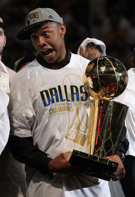 MIAMI, FL - JUNE 12:  Caron Butler of the Dallas Mavericks celebrates with the Larry O'Brien trophy after the Mavericks won 105-95 against the Miami Heat in Game Six of the 2011 NBA Finals at American Airlines Arena on June 12, 2011 in Miami, Florida. NOT