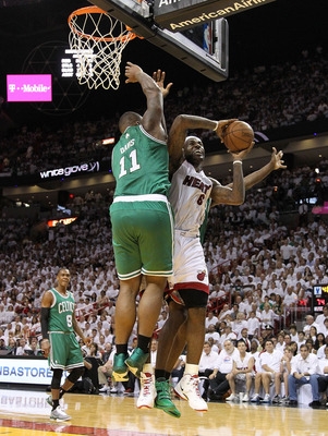MIAMI, FL - MAY 01:  LeBron James #6 of the Miami Heat is fouled by Glen Davis #11 of the Boston Celtics during Game One of the Eastern Conference Semifinals of the 2011 NBA Playoffs at American Airlines Arena on May 1, 2011 in Miami, Florida. NOTE TO USE