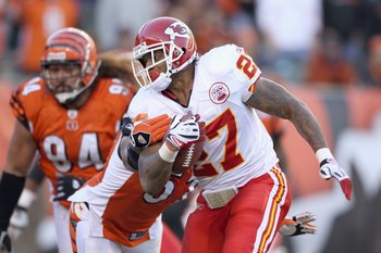 CINCINNATI - DECEMBER 28: Larry Johnson #27 of the Kansas City Chiefscarries the ball as he breaks a tackle during the NFL game against the Cincinnati Bengals on December 28, 2008 at Paul Brown Stadium in Cincinnati, Ohio.  (Photo by Andy Lyons/Getty Imag