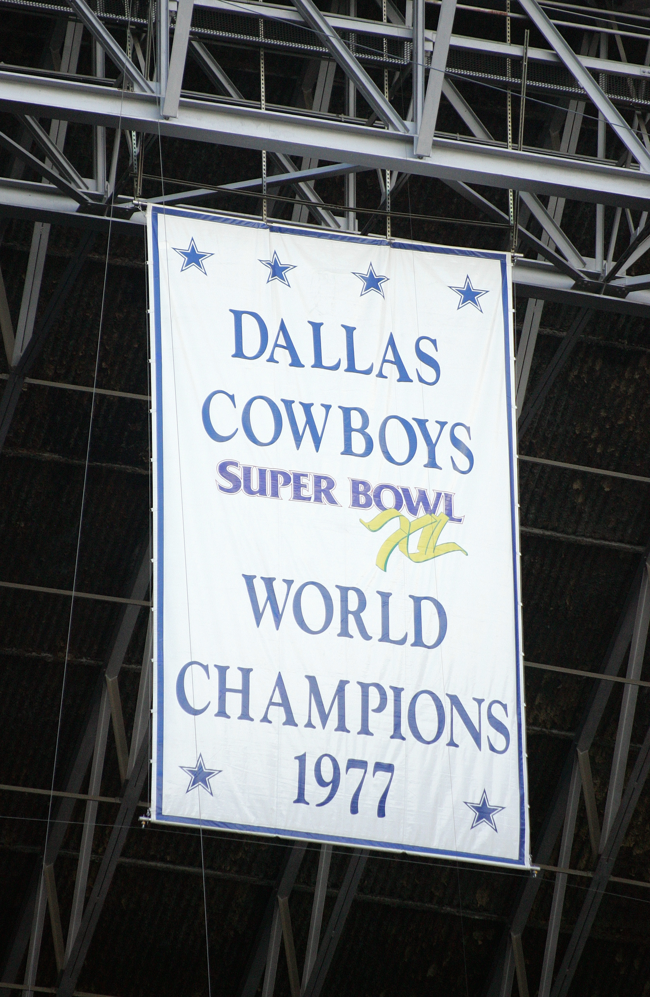 IRVING, TX - NOVEMBER 20:  A banner hangs from the rafters commemorating the 1977 Dallas Cowboys as Super Bowl XI Champions during the game between the Detroit Lions and the Dallas Cowboys on November 20, 2005 at Texas Stadium in Irving, Texas.  The Cowbo
