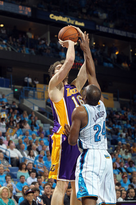 NEW ORLEANS, LA - APRIL 28:  Forward Pau Gasol #16 of the Los Angeles Lakers takes a shot against Carl Landry #24 of the New Orleans Hornets in Game Six of the Western Conference Quarterfinals in the 2011 NBA Playoffs on April 28, 2011 at New Orleans Aren