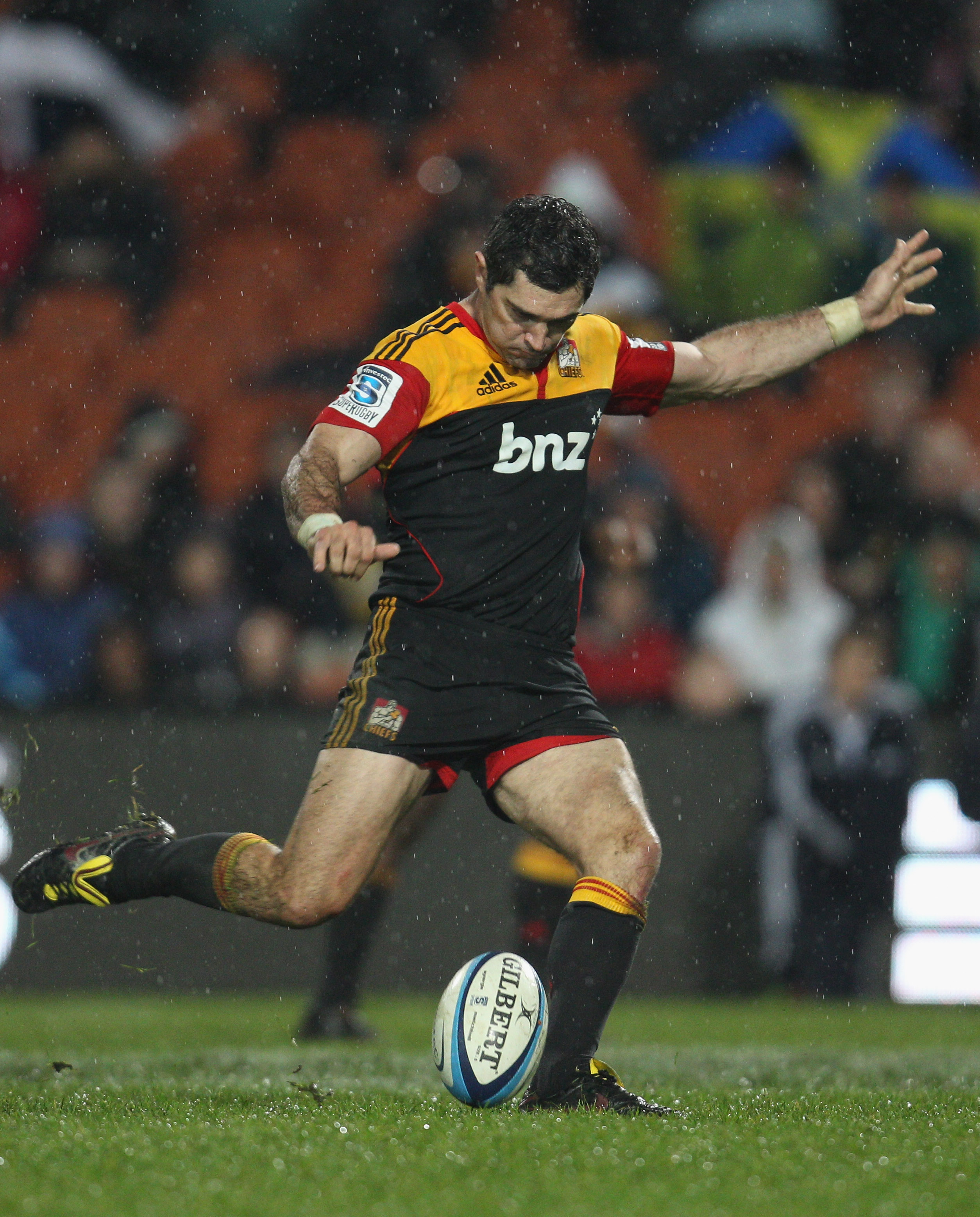 HAMILTON, NEW ZEALAND - JUNE 10: Stephen Donald of the Chiefs attempts a drop goal during the round 17 Super Rugby match between the Chiefs and the Hurricanes at Waikato Stadium on June 10, 2011 in Hamilton, New Zealand.  (Photo by Phil Walter/Getty Image