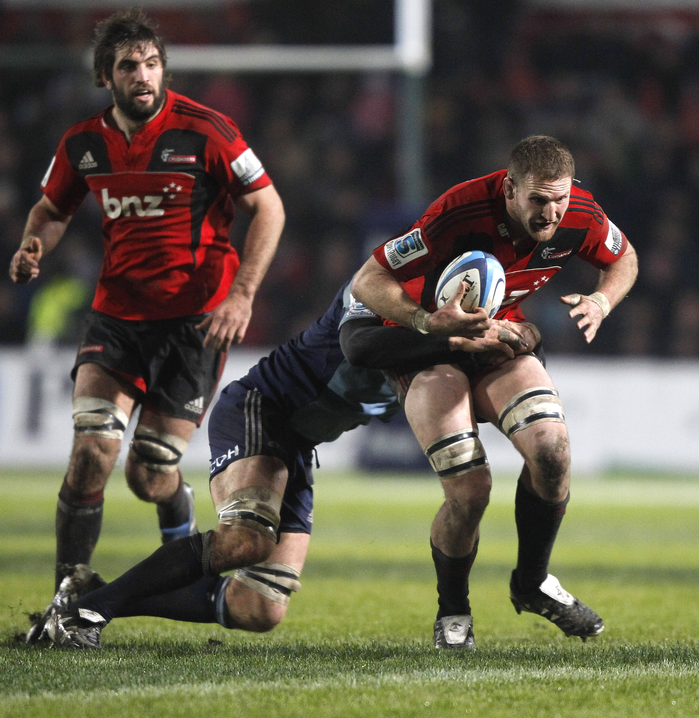 CHRISTCHURCH, NEW ZEALAND - JUNE 11: Kieran Read of the Crusaders is tackled during the round 17 Super Rugby match between the Crusaders and the Blues at Alpine Energy Stadium on June 11, 2011 in Christchurch, New Zealand.  (Photo by Martin Hunter/Getty I