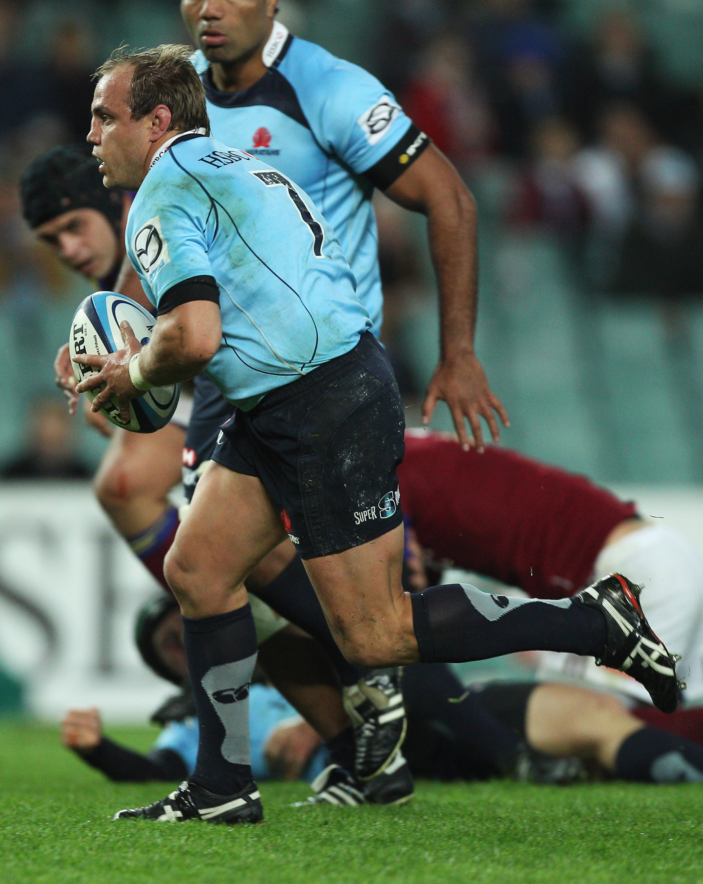 SYDNEY, AUSTRALIA - JUNE 11:  Phil Waugh of the Waratahs runs the ball during the round 17 Super Rugby match between the Waratahs and the Highlanders at the Sydney Football Stadium on June 11, 2011 in Sydney, Australia.  (Photo by Mark Kolbe/Getty Images)