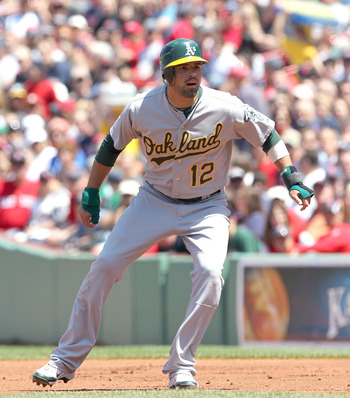 BOSTON, MA - JUNE 5:  David DeJesus #12 of the Oakland Athletics leads off first base against the Boston Red Sox at Fenway Park on June 5, 2011 in Boston, Massachusetts.  (Photo by Jim Rogash/Getty Images)