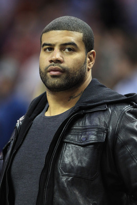 CHARLOTTE, NC - FEBRUARY 14:  Shawne Merriman of the Buffalo Bills watches on during the game between the Los Angeles Lakers and Charlotte Bobcats at Time Warner Cable Arena on February 14, 2011 in Charlotte, North Carolina. NOTE TO USER: User expressly a