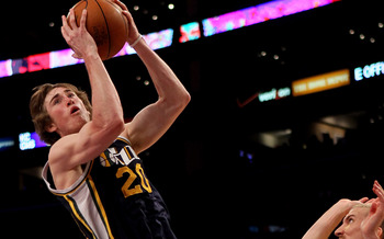 LOS ANGELES, CA - APRIL 05:  Gordon Hayward #20 of the Utah Jazz shoots over Steve Blake #5 of the Los Angeles Lakers at Staples Center on April 5, 2011 in Los Angeles, California. The Jazz won 86-85.  NOTE TO USER: User expressly acknowledges and agrees