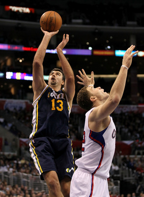 LOS ANGELES, CA - DECEMBER 29:  Mehmet Okur #13 of the Utah Jazz shoots over Blake Griffin #32 of the Los Angeles Clippers at Staples Center on December 29, 2010 in Los Angeles, California.   The Jazz won 103-85.  NOTE TO USER: User expressly acknowledges