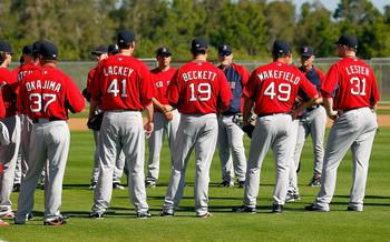 FORT MYERS, FL - FEBRUARY 19:  Pitchers Hideki Okajima #37, John Lackey #41, Josh Beckett #19, Tim Wakefield #49 and Jon Lester #31 of the Boston Red Sox talk with coaches during a Spring Training Workout Session at the Red Sox Player Development Complex