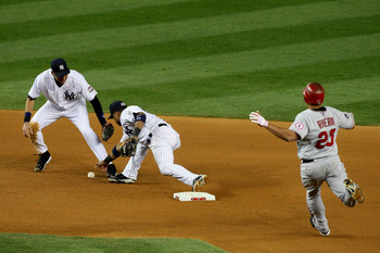 NEW YORK - OCTOBER 25:  Robinson Cano #24 of the New York Yankees forces out Juan Rivera #20 of the Los Angeles Angels of Anaheim on a fielder's choice in the top of the seventh inning of Game Six of the ALCS during the 2009 MLB Playoffs at Yankee Stadium