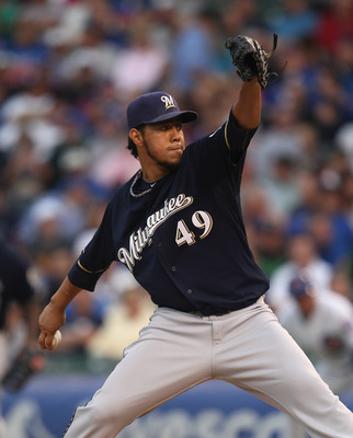 CHICAGO, IL - JUNE 14:  Starting pitcher Yovani Gallardo #49 of the Milwaukee Brewers delivers the ball against the Chicago Cubs at Wrigley Field on June 14, 2011 in Chicago, Illinois.  (Photo by Jonathan Daniel/Getty Images)