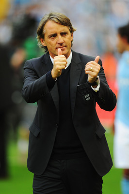 LONDON, ENGLAND - MAY 14:  Roberto Mancini reacts after his Manchester City team wins the FA Cup sponsored by E.ON Final match between Manchester City and Stoke City at Wembley Stadium on May 14, 2011 in London, England.  (Photo by Mike Hewitt/Getty Image
