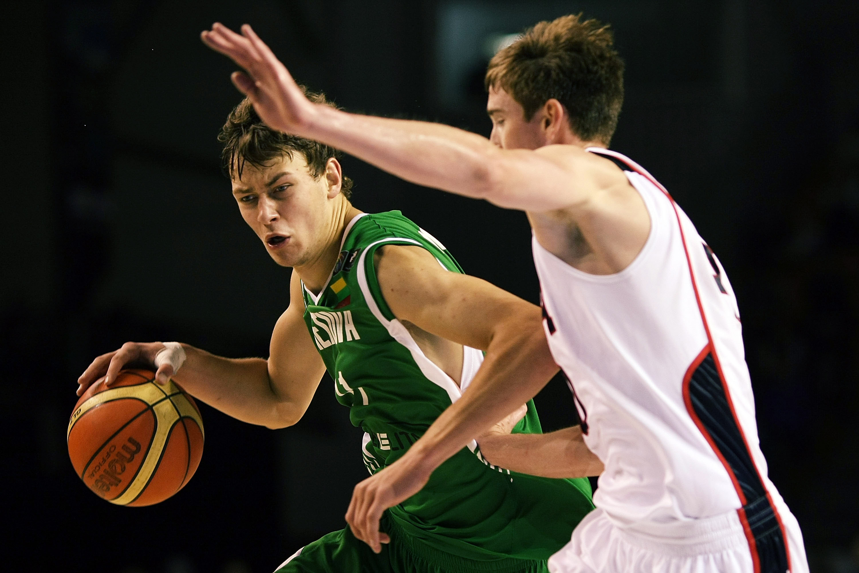 AUCKLAND, NEW ZEALAND - JULY 08:  Donatas Motiejunas of Lithuania tries to get past Gordon Hayward of the United States defends during the U19 Basketball World Championships match between the United States and Lithuania at North Shore Events Centre on Jul