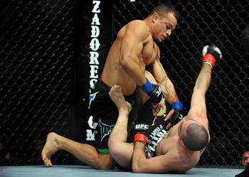 LOS ANGELES, CA - OCTOBER 24:  UFC fighter Gleison Tibau (top) battles with UFC fighter Josh Neer during their Lightweight 'Swing' bout at UFC 104: Machida vs. Shogun at Staples Center on October 24, 2009 in Los Angeles, California.  (Photo by Jon Kopalof