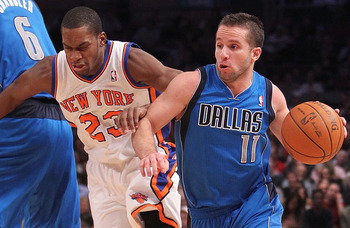 NEW YORK, NY - FEBRUARY 02: Jose Barea #11 of the Dallas Mavericks drives past Toney Douglas #23   of the New York Knicks  at Madison Square Garden on February 2, 2011 in New York City. NOTE TO USER: User expressly acknowledges and agrees that, by downloa