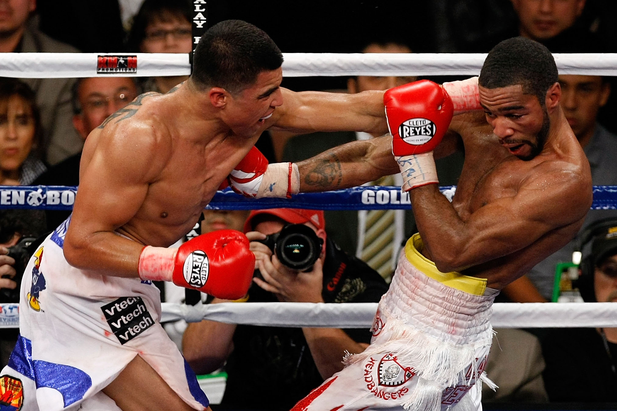LAS VEGAS - DECEMBER 11:  (L-R) Victor Ortiz and Lamont Petersen exchange blows during the super lightweight fight at Mandalay Bay Events Center on December 11, 2010 in Las Vegas, Nevada.  (Photo by Ethan Miller/Getty Images)