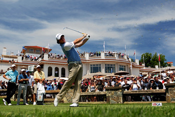 BETHESDA, MD - JUNE 15:  Rory McIlroy of Northern Ireland hits a tee shot in front of the clubhouse during a practice round prior to the start of the 111th U.S. Open at Congressional Country Club on June 15, 2011 in Bethesda, Maryland.  (Photo by Ross Kin