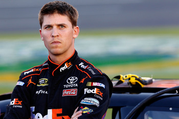 CHARLOTTE, NC - MAY 26:  Denny Hamlin, driver of the #11 FedEx Express Toyota, stands on the grid during qualifying for the NASCAR Sprint Cup Series Coca-Cola 600 at Charlotte Motor Speedway on May 26, 2011 in Charlotte, North Carolina.  (Photo by Geoff B