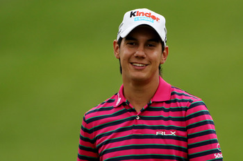 BETHESDA, MD - JUNE 14:  Matteo Manassero of Italy smiles during a practice round prior to the start of the 111th U.S. Open at Congressional Country Club on June 14, 2011 in Bethesda, Maryland.  (Photo by Andrew Redington/Getty Images)