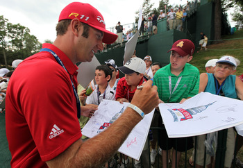 BETHESDA, MD - JUNE 14:  Dustin Johnson signs his autograph for fans during a practice round prior to the start of the 111th U.S. Open at Congressional Country Club on June 14, 2011 in Bethesda, Maryland.  (Photo by Rob Carr/Getty Images)