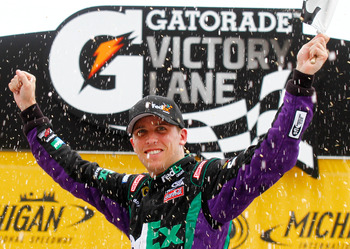 BROOKLYN, MI - JUNE 13:  Denny Hamlin, driver of the #11 FedEx Ground Toyota, celebrates in Victory Lane after winning the NASCAR Sprint Cup Series Heluva Good! Sour Cream Dips 400 at Michigan International Speedway on June 13, 2010 in Brooklyn, Michigan.