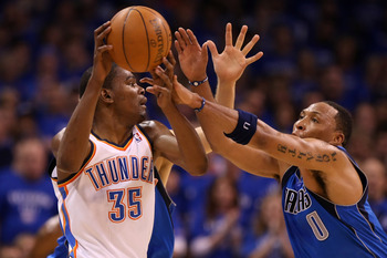 OKLAHOMA CITY, OK - MAY 23:  Kevin Durant #35 of the Oklahoma City Thunder moves the ball as Shawn Marion #0 of the Dallas Mavericks goes after the ball in the first half in Game Four of the Western Conference Finals during the 2011 NBA Playoffs at Oklaho