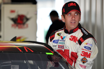 LONG POND, PA - JUNE 10:  Greg Biffle, driver of the #16 3M Ford, climbs into his car in the garage area during practice for the NASCAR Sprint Cup Series 5-Hour Energy 500 at Pocono Raceway on June 10, 2011 in Long Pond, Pennsylvania.  (Photo by Drew Hall